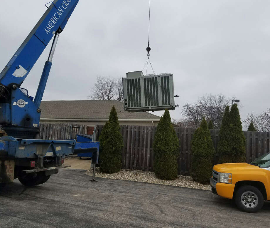 Owners of the old Madison Mutual Insurance building on Route 157 donated their HVAC unit to the Edwardsville Public Library.