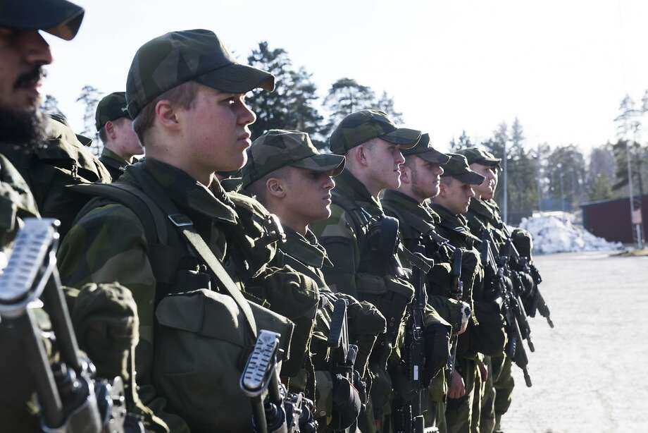Young recruits during an inspection, Thursday, March 2, 2017 at the regiment in Enkoping 70 km north-west of Stockholm, Sweden. Sweden's left-leaning government introduced a military draft for both men and women Thursday because of what its defense minister called a deteriorating security environment in Europe and around Sweden. (Fredrik Sandberg /TT via AP) Photo: Fredrik Sandberg, Associated Press