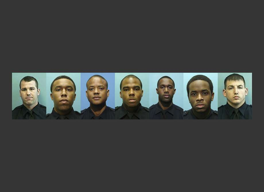 RETRANSMITTED FOR IMAGE SIZE - These undated photos provided by the Baltimore Police Department show, from left, Daniel Hersl, Evodio Hendrix, Jemell Rayam, Marcus Taylor, Maurice Ward, Momodu Gando and Wayne Jenkins, the seven police officers who are facing charges of robbery, extortion and overtime fraud, and are accused of stealing money and drugs from victims, some of whom had not committed crimes. (Baltimore Police Department via AP) Photo: Associated Press