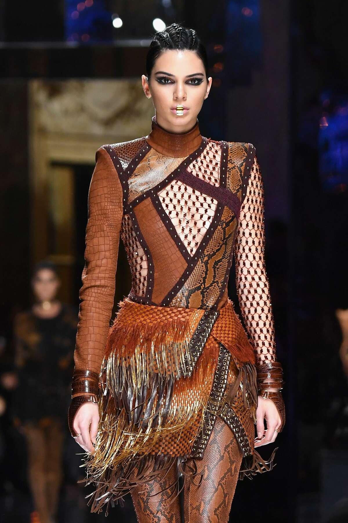 Kendall Jenner walks the runway during the Balmain show as part of the Paris Fashion Week Womenswear Fall/Winter 2017/2018.