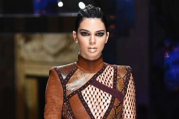 PARIS, FRANCE - MARCH 02:  Kendall Jenner walks the runway during the Balmain show as part of the Paris Fashion Week Womenswear Fall/Winter 2017/2018  on March 2, 2017 in Paris, France.  (Photo by Pascal Le Segretain/Getty Images)