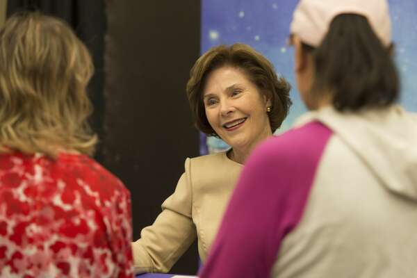 Laura Bush greets people as she signs copies of her book, Our Great Big Backyard Thursday 03-02-17 at the Centennial Library. Tim Fischer/Reporter-Telegram