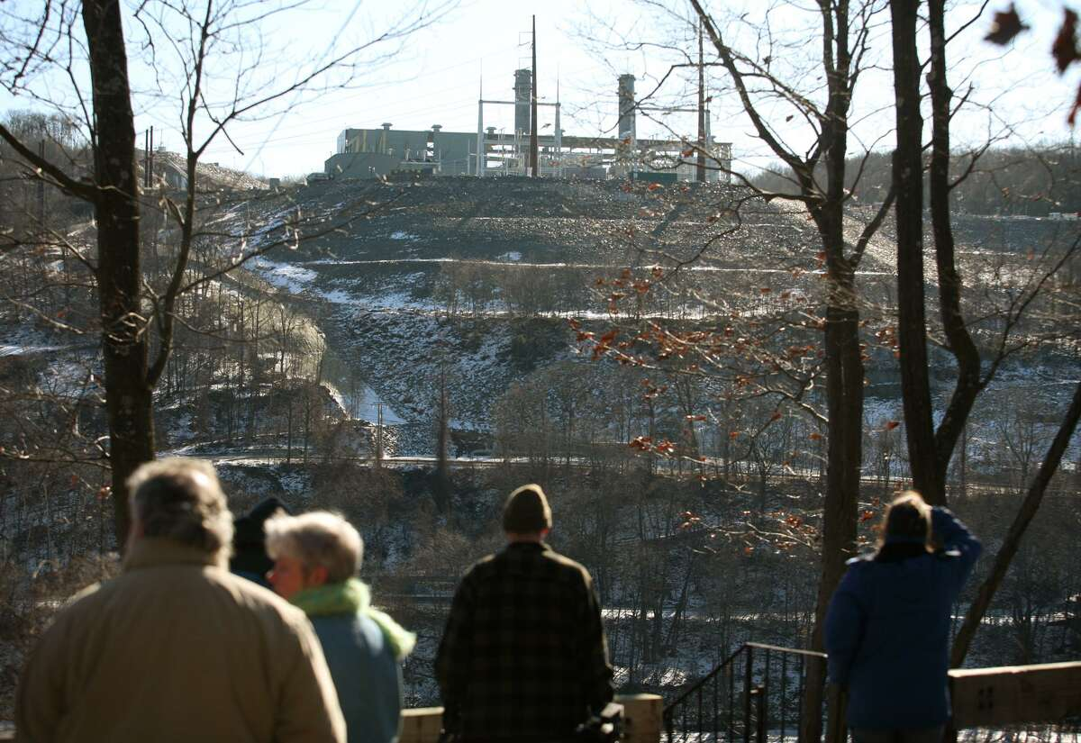 On Feb. 7, 2010, bystanders in Portland, Conn. view the Kleen Energy power plant site across the Connecticut River in Middletown, following a massive explosion caused by ignition of natural gas that had been blown through pipes to clear debris.