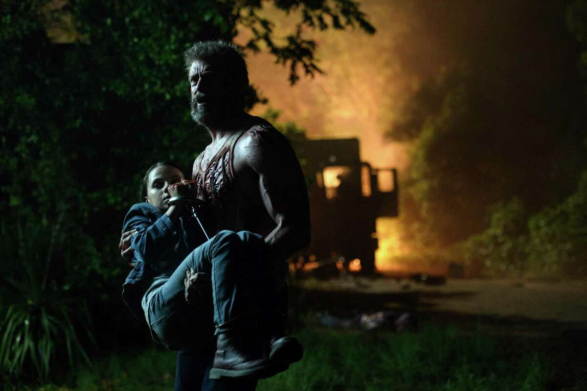 This image released by Twentieth Century Fox shows Dafne Keen, left, and Hugh Jackman in a scene from