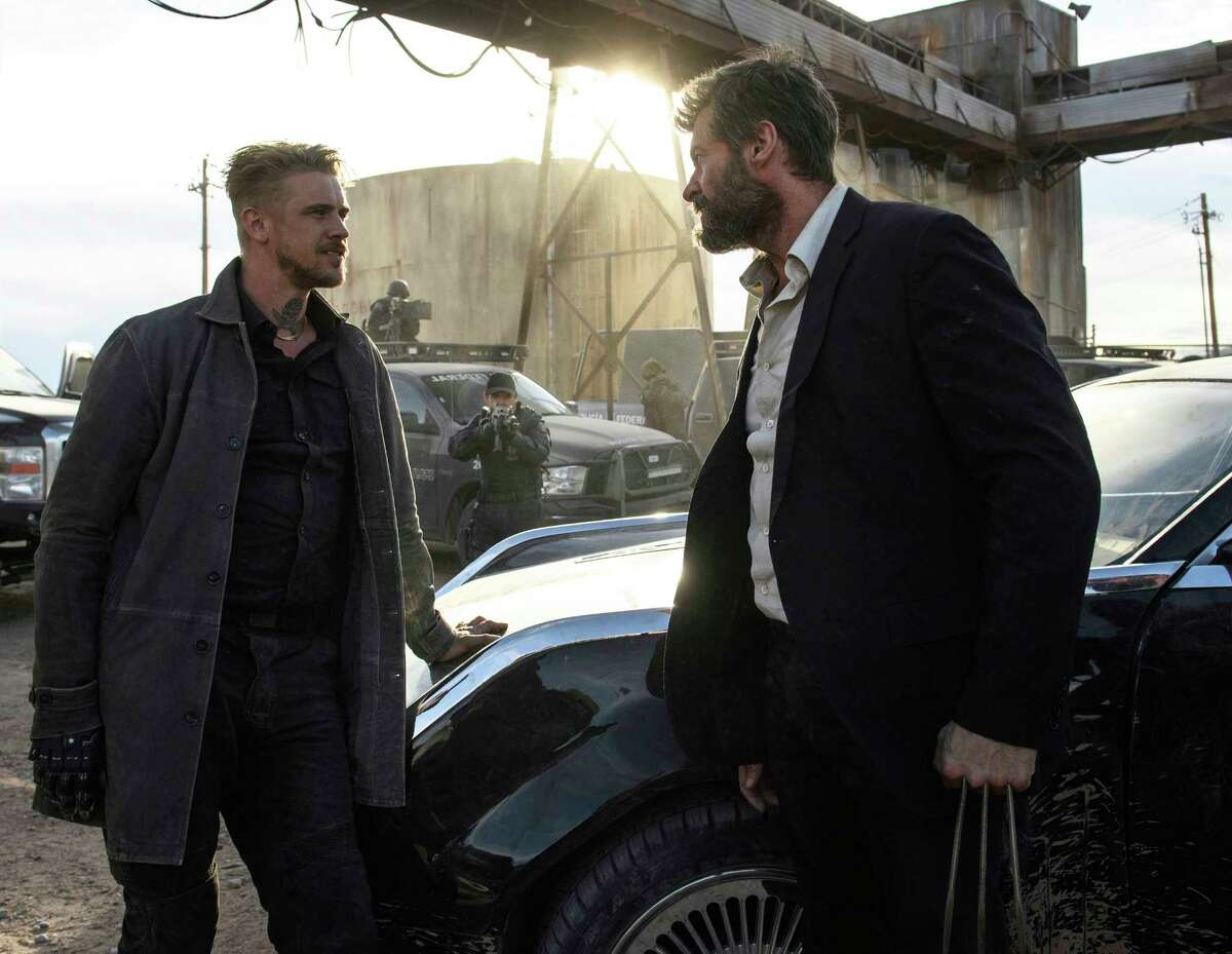 This image released by Twentieth Century Fox shows Boyd Holbrook, left, and Hugh Jackman in a scene from