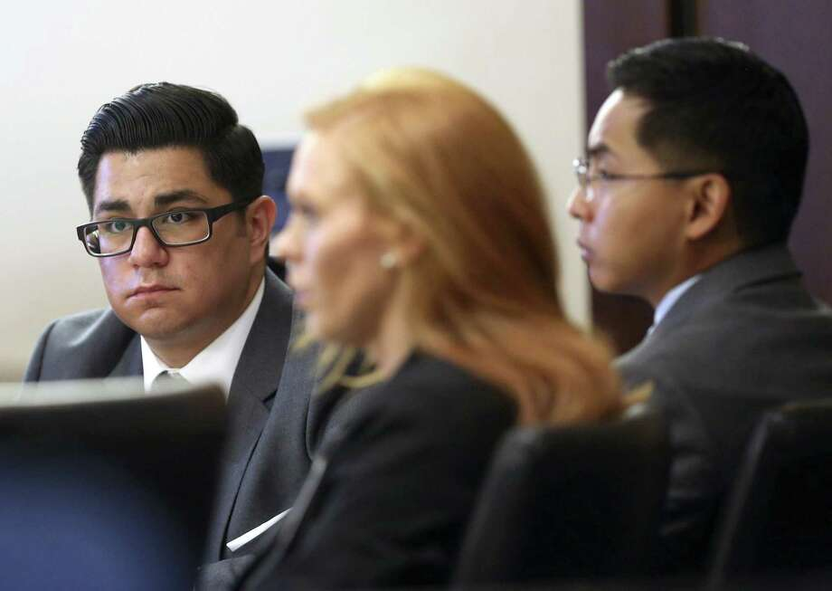 Former San Antonio Police officers Alejandro Chapa, left and Emmanuel Galindo, right. listen to testimony Wednesday, March 1, 2017 with one of their attorneys, Leigh Cutter. The officers are on trial for charges of compelling prostitution, official oppression and aggravated sexual assault in 2015. Chapa and Galindo are accused of recruiting and duping women into having sex with them. Photo: William Luther /San Antonio Express-News / © 2017 San Antonio Express-News