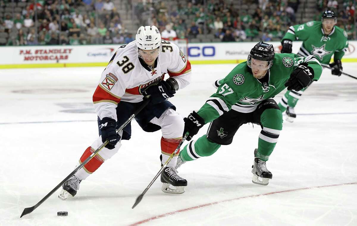 DALLAS, TX - OCTOBER 04: Shane Harper #38 of the Florida Panthers skates the puck against Cole Ully #57 of the Dallas Stars during a preseason game at American Airlines Center on October 4, 2016 in Dallas, Texas. (Photo by Ronald Martinez/Getty Images) ORG XMIT: 660763579