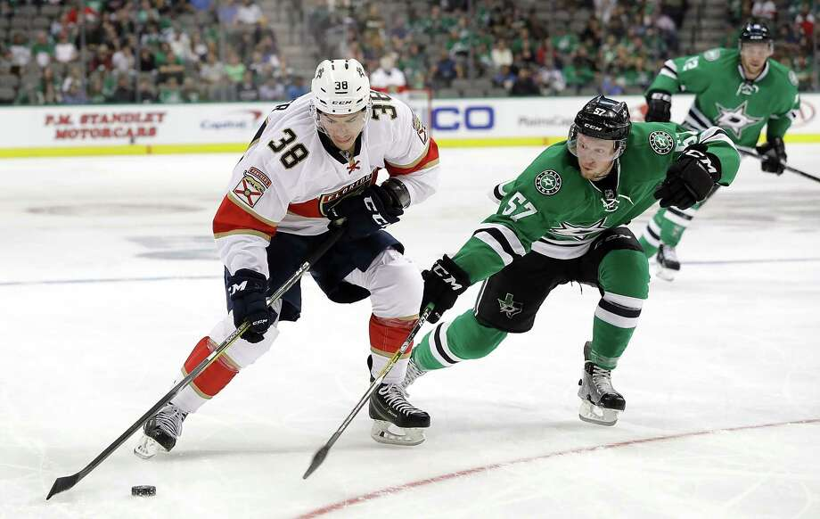 DALLAS, TX - OCTOBER 04:  Shane Harper #38 of the Florida Panthers skates the puck against Cole Ully #57 of the Dallas Stars during a preseason game at American Airlines Center on October 4, 2016 in Dallas, Texas.  (Photo by Ronald Martinez/Getty Images) ORG XMIT: 660763579 Photo: Ronald Martinez / 2016 Getty Images