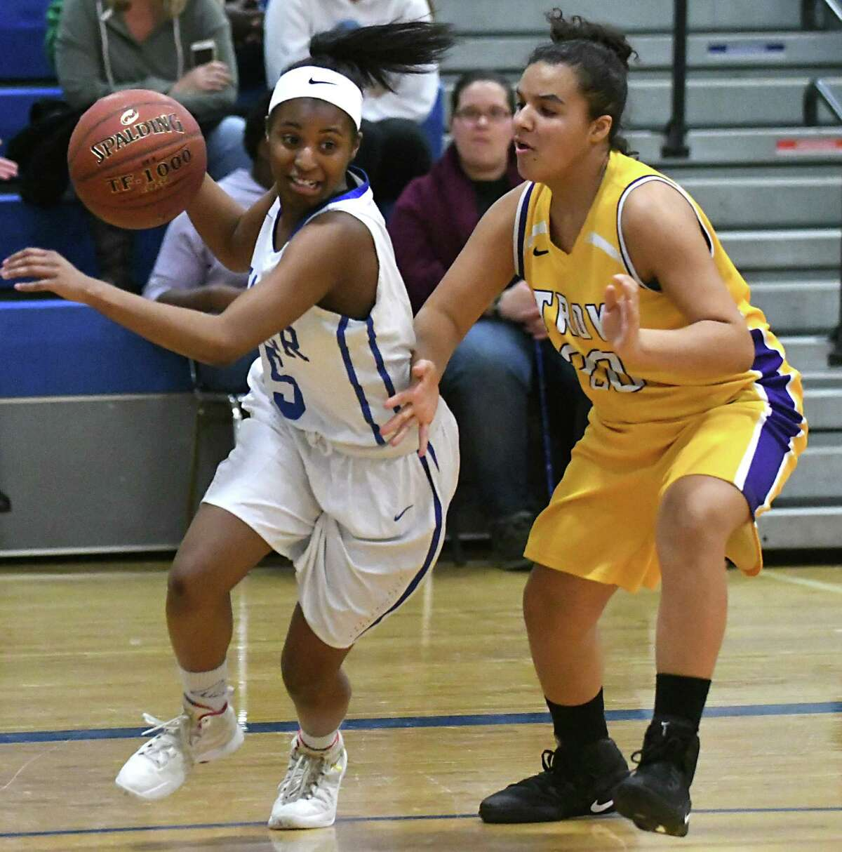 Shaker's Briannah Dukes is guarded by Troy's Nadia Brown as she drives baseline to the basket during a Class AA girls' basketball game on Wednesday, Feb. 22, 2017 in Latham, N.Y. (Lori Van Buren / Times Union)