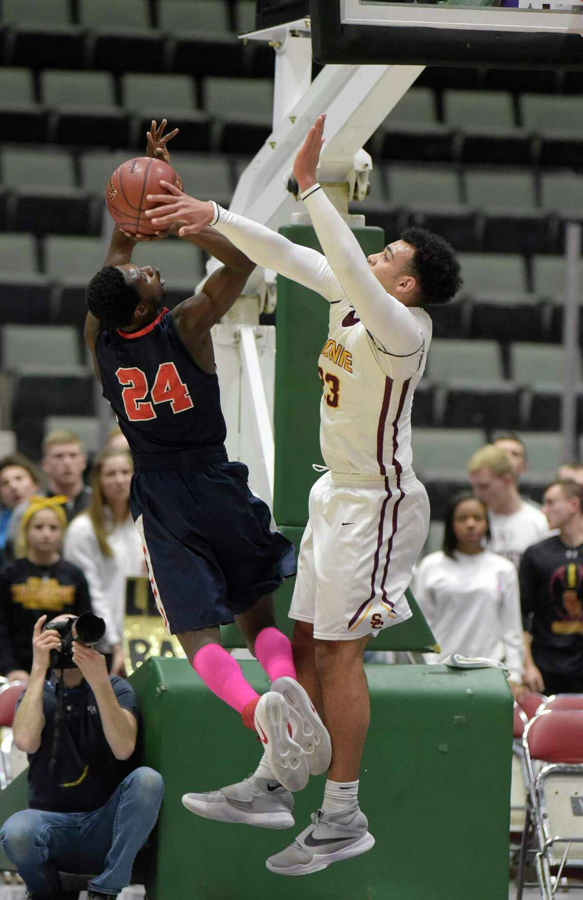 John Ryals of Schenectady, left, puts up a shot as Isaiah Moll of Colonie goes for the block during their Class AA semifinal game at the Glens Falls Civic Center on Tuesday, Feb. 28, 2017, in Glens Falls, N.Y. (Paul Buckowski / Times Union)