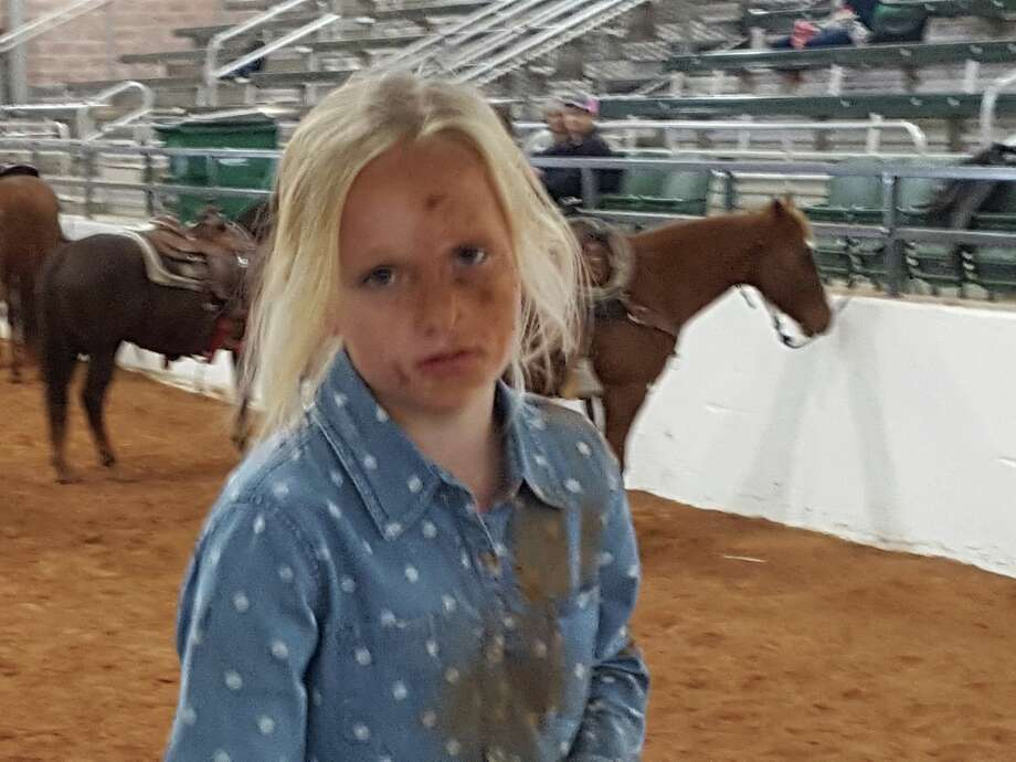 "Kameryn White is a 3rd grader who lives about 3 hours north of San Antonio in Hico. At 8 years old, she became a Facebook hit when her family shared a video on Jan. 21. The 26-second clip shows Kameryn falling off a horse into a ""scorpion"" move then tying up a goat without a second of hesitation. Photo: Corey Roberts White"
