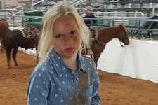 """Kameryn White is a 3rd grader who lives about 3 hours north of San Antonio in Hico. At 8 years old, she became a Facebook hit when her family shared a video on Jan. 21. The 26-second clip shows Kameryn falling off a horse into a """"scorpion"""" move then tying up a goat without a second of hesitation."""