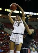 California's Kristine Anigwe (31) shoots over Southern California's Kristen Simon in the first half of an NCAA college basketball game in the Pac-12 Conference tournament, Thursday, March 2, 2017, in Seattle. (AP Photo/Elaine Thompson)