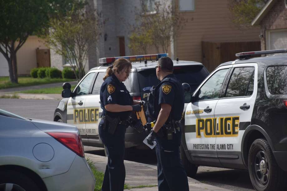 Officers investigate a burglary Thursday, March 2, 2017, at the home of a San Antonio police sergeant on the North Side. Photo: Caleb Downs / San Antonio Express-News