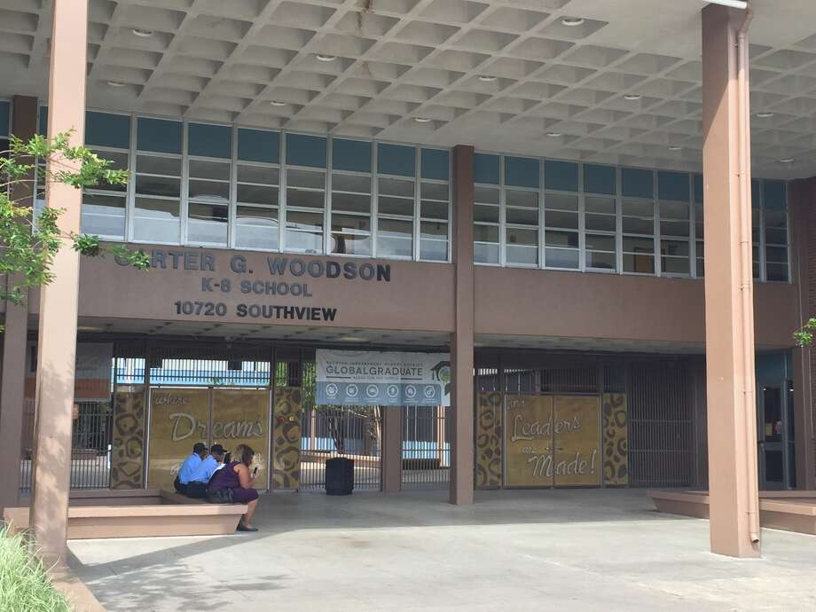 Students sit outside the entrance of Carter G. Woodson school.