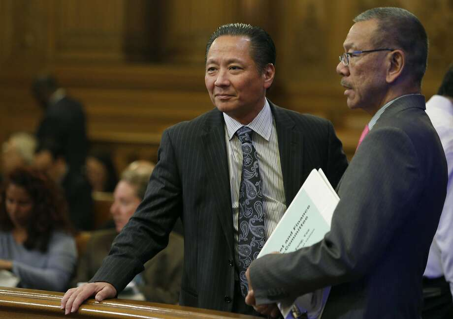 Public Defender Jeff Adachi meets with Supervisor Norman Yee before a meeting of the Budget and Finance Sub-Committee at City Hall in San Francisco, Calif. on Thursday, March 2, 2017 to consider appropriating funds to establish a legal unit within Adachi's office to defend immigrants in deportation cases. Photo: Paul Chinn, The Chronicle