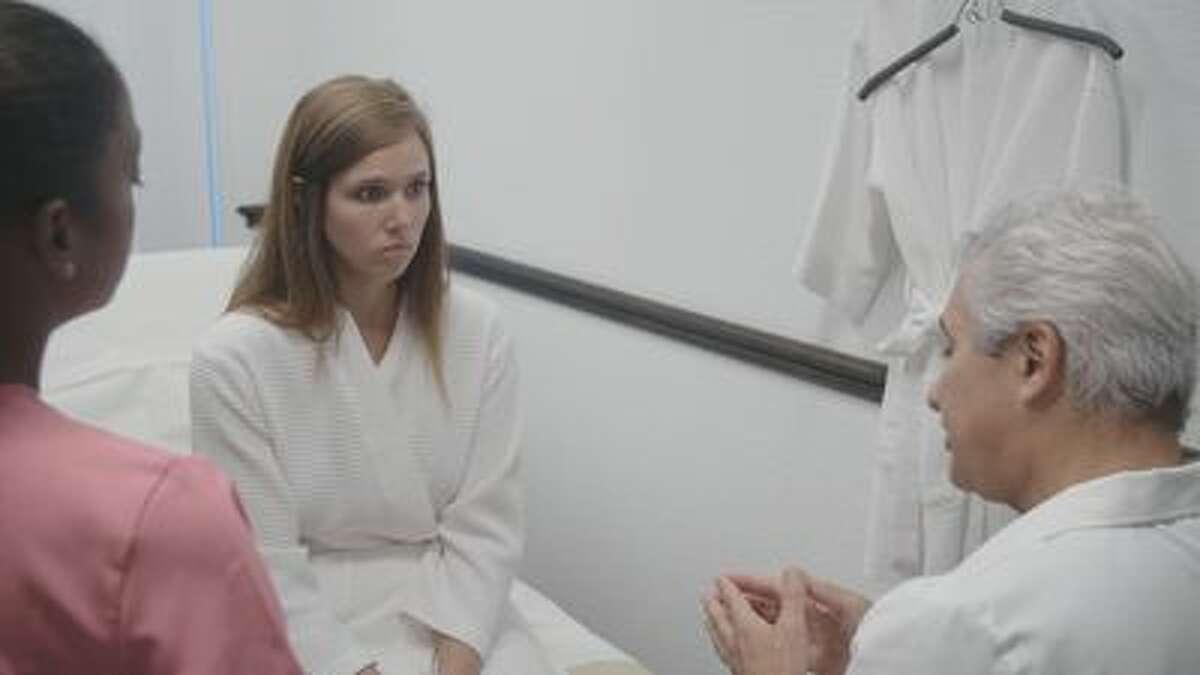 Dr. LoMonaco has a consultation with Ashley.