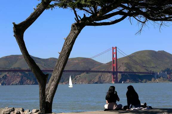 Aastha Nagar, (left) of Montreal who is visiting her friend Julia Goodwin of San Francisco, enjoy the view and lunch along Crissy Field in San Francisco, Ca. on Thurs. March 2, 2017.