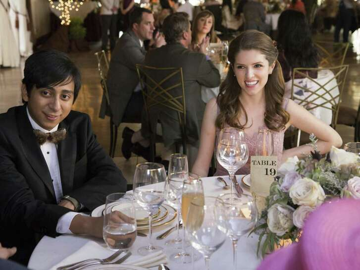 "Tony Revolori, left, and Anna Kendrick in a scene from ""Table 19."""
