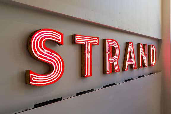 The original Strand Theater sign was restored and hangs in the lobby at the new American Conservatory Theater which officially opens on May 14 on Market Street in San Francisco, Thursday, April 30, 2015.