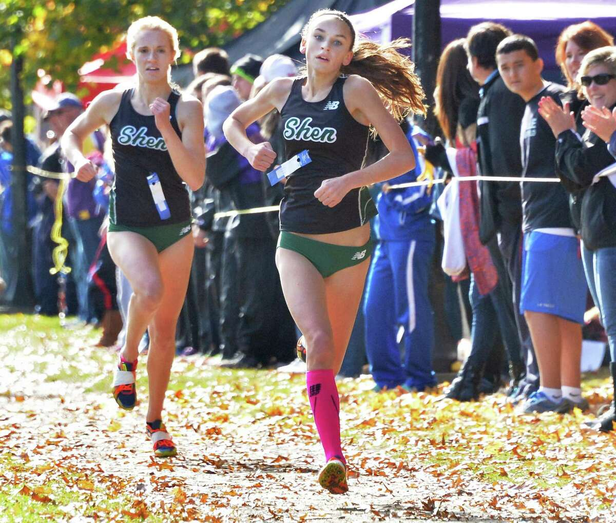 Shen's Daniella Jordan, right, and teammate Julia Zachgo finish first and second in the girl's Class A Section II Cross Country Championships at Saratoga Spa State Park Friday Oct. 31, 2014, in Saratoga Springs, NY. (John Carl D'Annibale / Times Union)