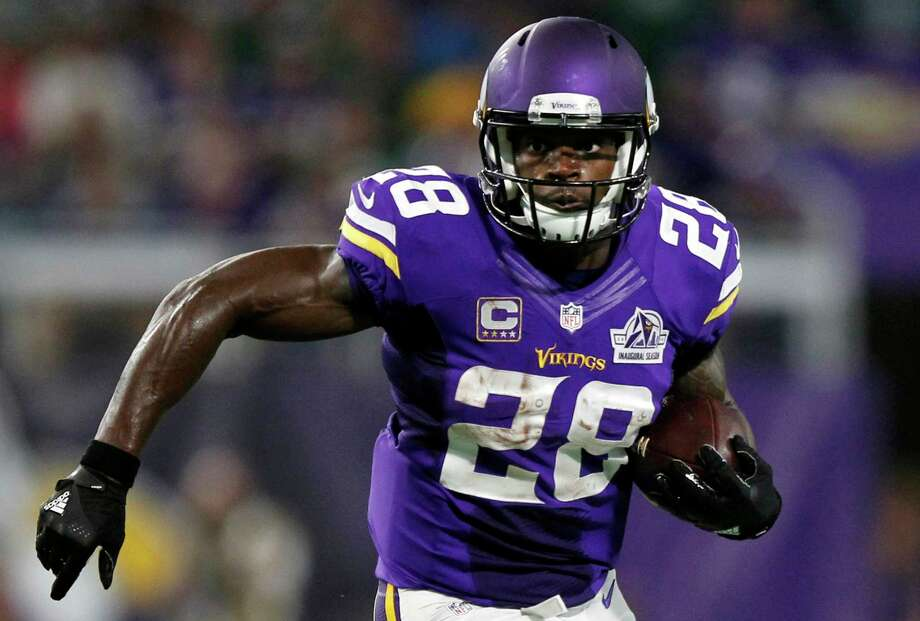 FILE - In this Sept. 18, 2016, file photo, Minnesota Vikings running back Adrian Peterson carries the ball during the first half of an NFL football game against the Green Bay Packers in Minneapolis. The Vikings on Tuesday, Feb. 28, 2017. have declined to exercise their option for next season on Peterson's contract. This makes the franchise's all-time leading rusher an unrestricted free agent when the market opens next week. (AP Photo/Andy Clayton-King, File) Photo: Andy Clayton-King, FRE / FR51399 AP