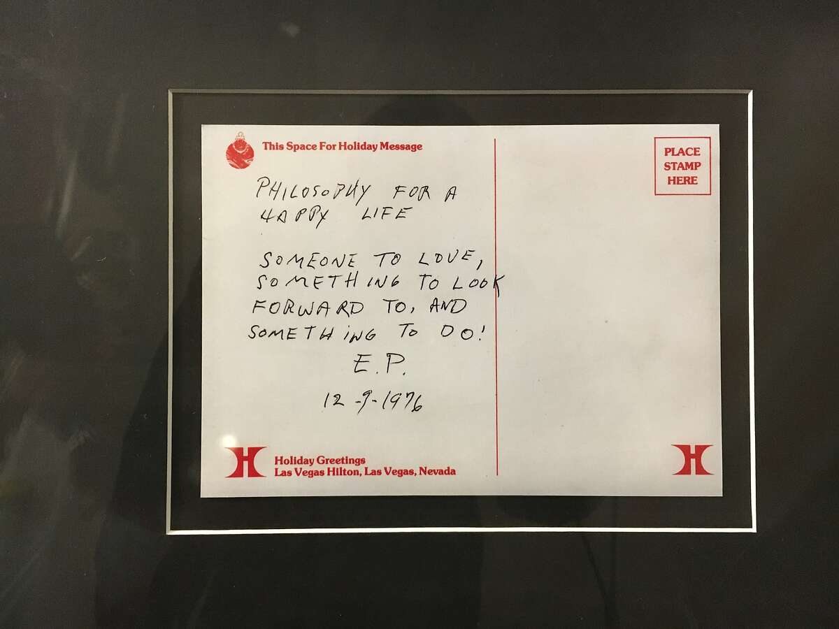 A note written by Elvis Presley on the back of an unmailed postcard from the Las Vegas Hilton is part of a display of Presley-related object at the Hard Rock Hotel in Las Vegas.