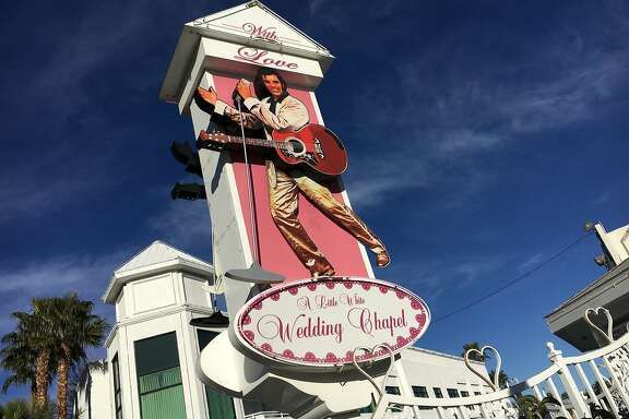 The swiveling image of Elvis adorns a sign in front of one of the many chapels along Las Vegas Boulevard that themed weddings.