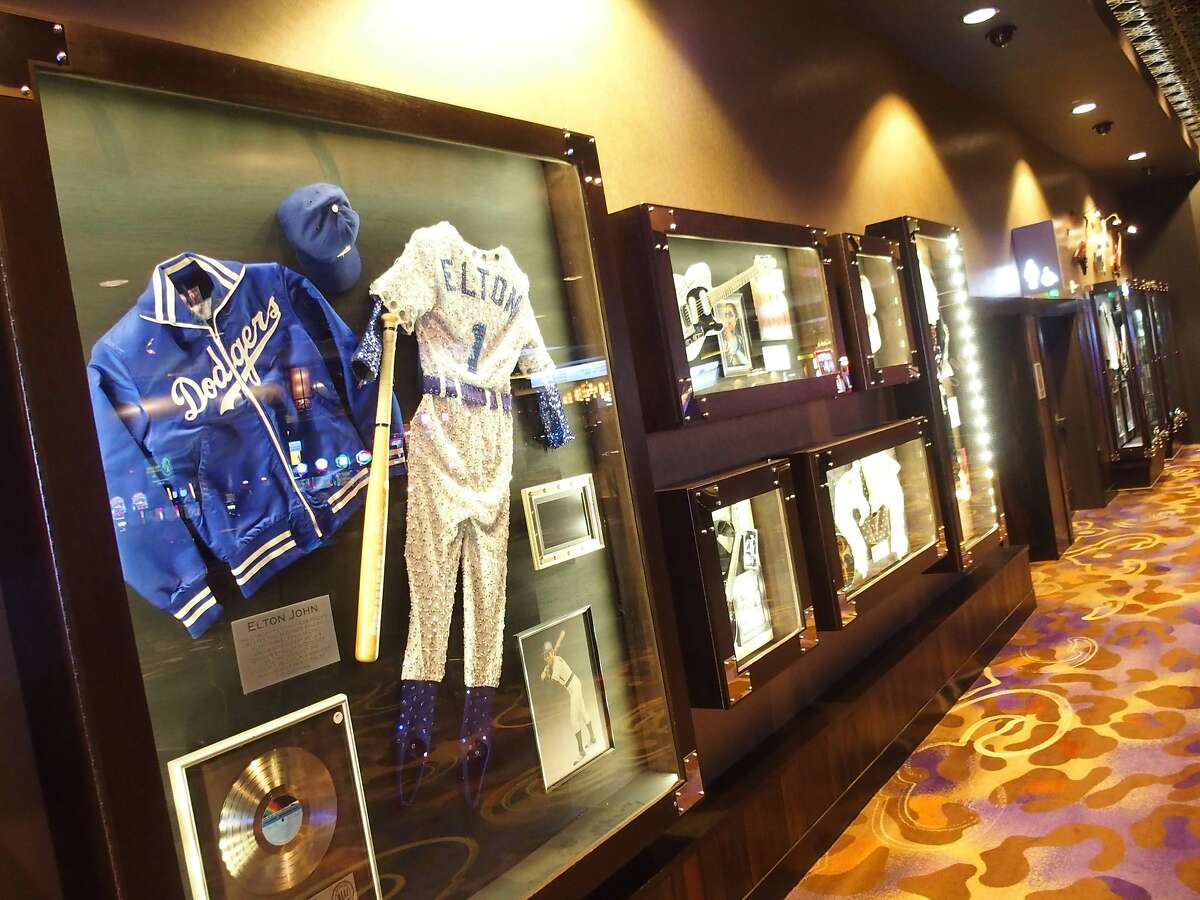 Displays of rock memorabilia lines the halls and rooms at the Hard Rock Hotel in Las Vegas, including a Dodgers-themed costume once worn by Elton John.