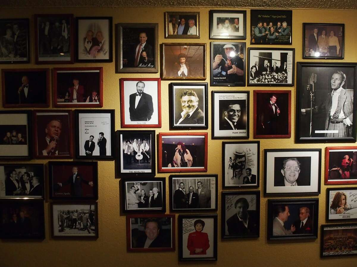 Framed photos, most autographed, fills a wall inside the Italian American Club in Las Vegas.