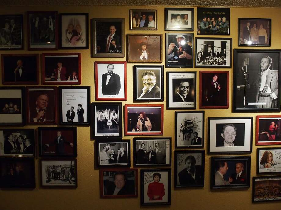 Framed photos, most autographed, fills a wall inside the Italian American Club in Las Vegas. Photo: Spud Hilton, The Chronicle