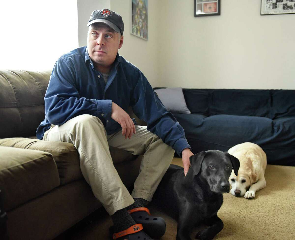 Jason Gough discusses being sexually abused as a child during an interview at his home Friday Feb. 17, 2017 in Delmar, NY. Dogs are Sophie and Bernie, right. (John Carl D'Annibale / Times Union)