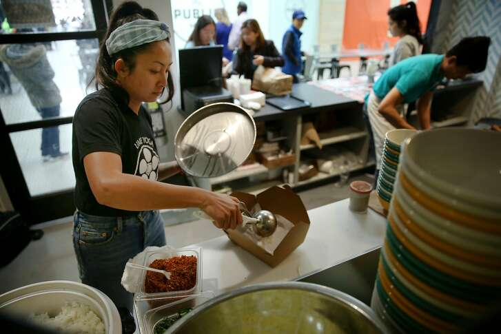 Nite Yun prepares a food order at Nyum Bai on Thursday, March 2, 2017, in Emeryville, Calif. Yun, the owner, was aided by La Cocina, a kitchen incubator that helps women of color and immigrants by providing affordable kitchen space.