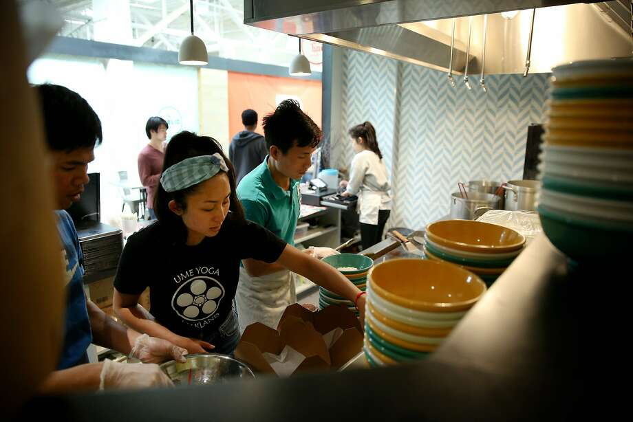 Nite Yun (wearing a bandana) and her employees prepare food orders at Nyum Bai's old location in Emeryville. Photo: Santiago Mejia / The Chronicle