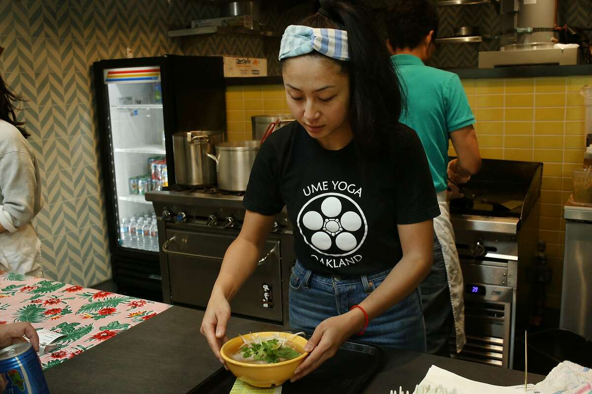 Nite Yun prepares soup for a customer at Nyum Bai on March 2 in Emeryville. Yun, the owner, was aided by La Cocina, a kitchen incubator that helps women of color and immigrants by providing affordable kitchen space.