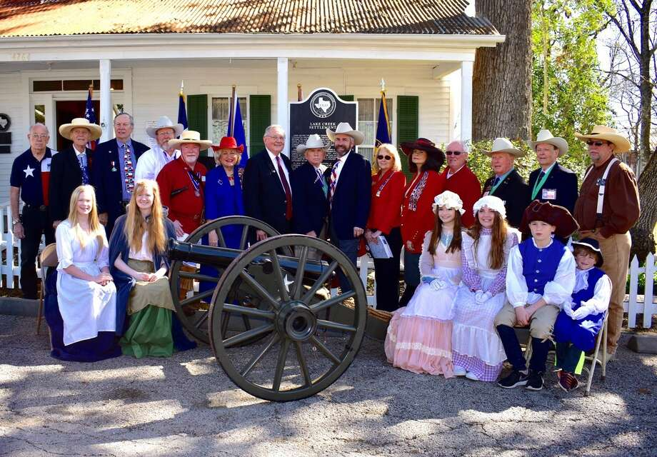 Dignitaries and descendants in front of the Nat Hart Davis Museum and new Lake Creek Settlement marker as they are seated behind the Twin Sisters Cannon. The historic marker was dedicated Feb. 25 in Montgomery.