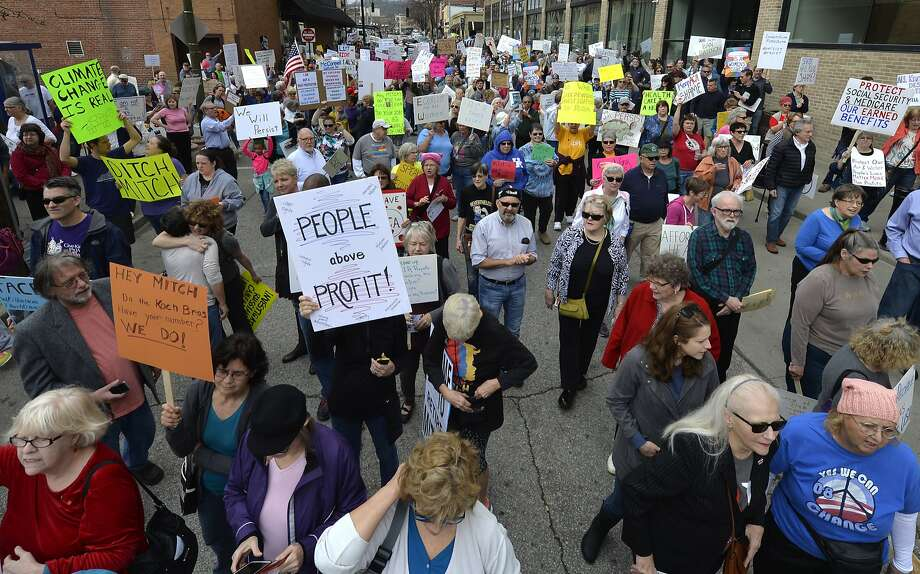 Protesters gathered last month to protest the appearance of Senate Majority Leader Mitch McConnell, who was scheduled to speak at a Chamber of Commerce meeting in Covington, Ky. Photo: Timothy D. Easley, Associated Press