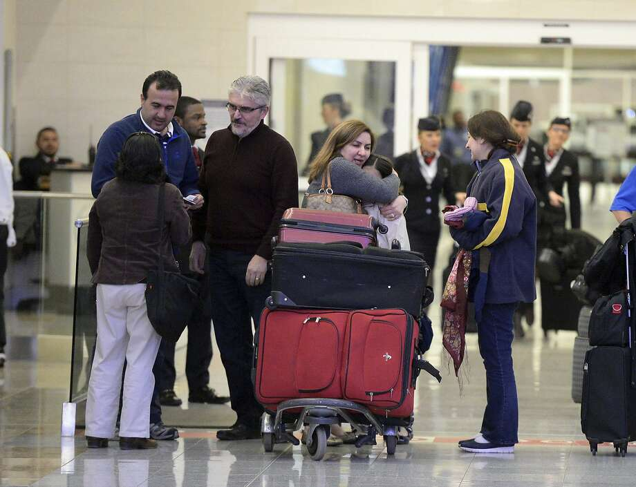 Mansour Kenereh (center) and his family were among those detained at Atlanta's airport. Photo: Kent D. Johnson, Associated Press