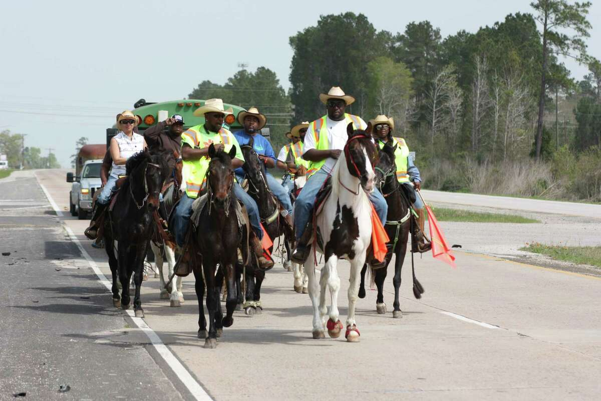 A group of trail riders with thePiney Woods Trail Ride Association travels through Cleveland on Wednesday, March 1. The riders were en route to the Houston Livestock Show and Rodeo. Every year, they camp at Stancil Park in Cleveland before setting off for another leg of the journey.