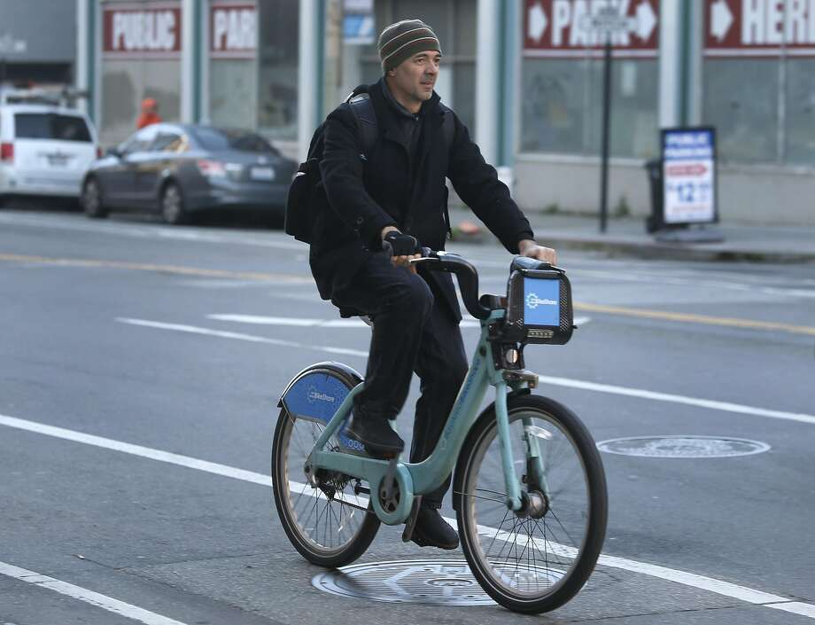 A commuter rides a Bay Area Bike Share bicycle on Townsend Street near the Caltrain Terminal in San Francisco. Photo: Paul Chinn, The Chronicle