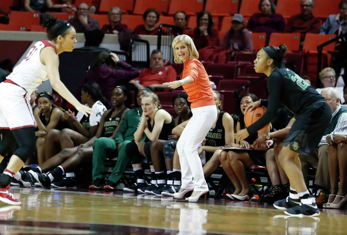 Baylor head coach Kim Mulkey, center, coaches her team against Oklahoma during the second half of an NCAA college basketball game in Norman, Okla., Monday, Feb. 27, 2017. Baylor won 103-64.
