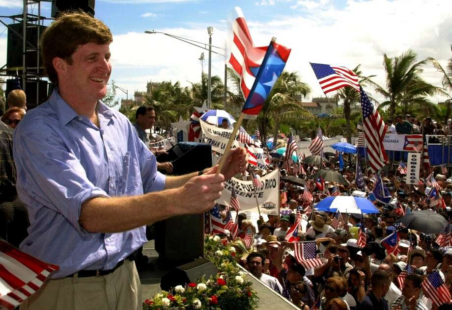 Rep. Patrick Kennedy, D-RI, waves a Puerto Rican flag during a rally celebrating U.S. Citizenship at the Capitol in San Juan, Puerto Rico Sunday, March 5, 2000.  Puerto Ricans were granted U.S. citizenship by President Woodrow Wilson in 1917 through the Jones Act. Photo: LYNNE SLADKY, AP