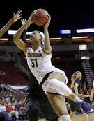 California's Kristine Anigwe drives against Southern California in the second half of an NCAA college basketball game in the Pac-12 Conference tournament, Thursday, March 2, 2017, in Seattle. California won 71-58. Anigwe led all scorers with 34 points and California won 71-58. (AP Photo/Elaine Thompson)