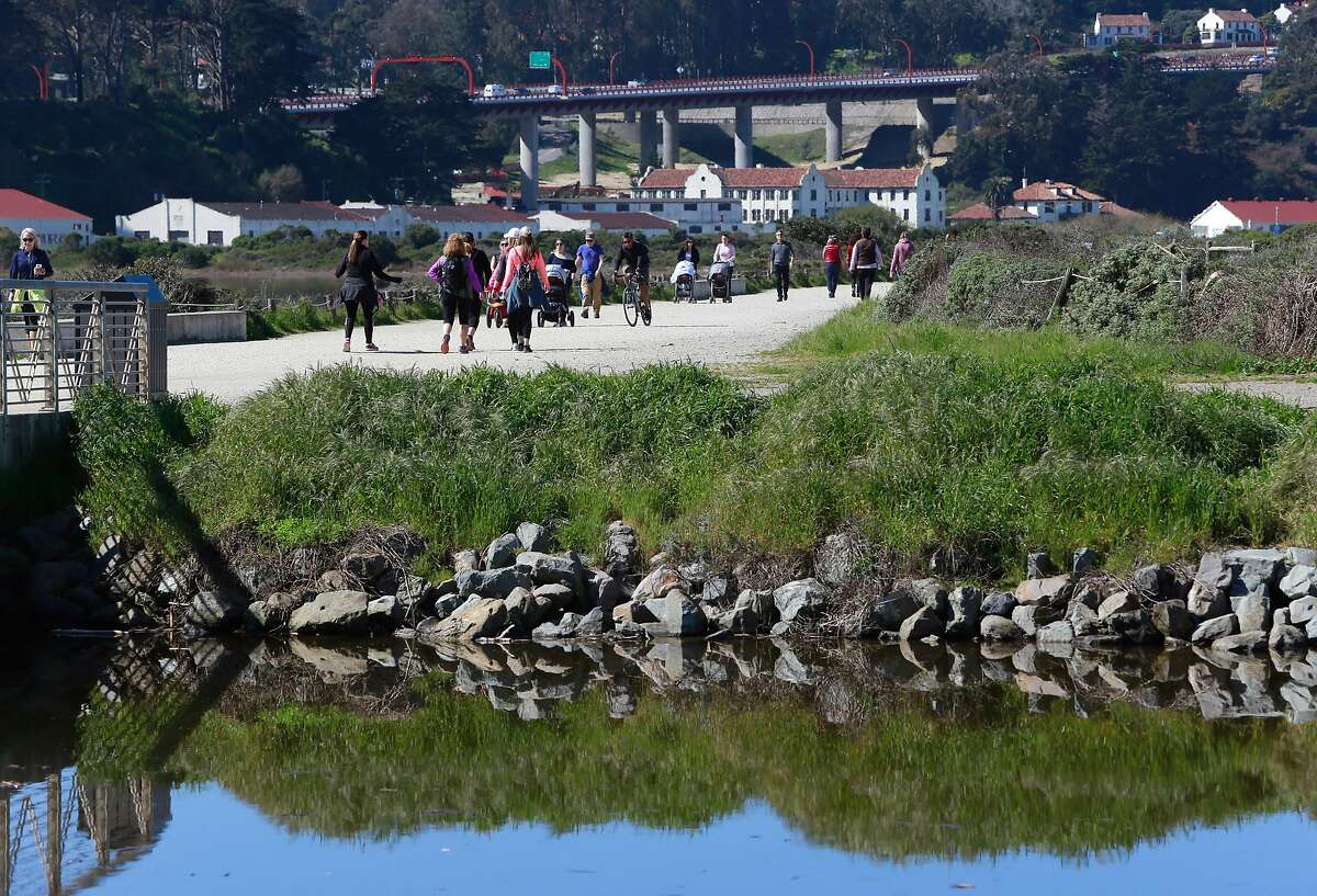 Visitors enjoy the pedestrian gravel path along Crissy Field in San Francisco, Ca. on Thurs. March 2, 2017. Major renovations to the park are about ready to begin.
