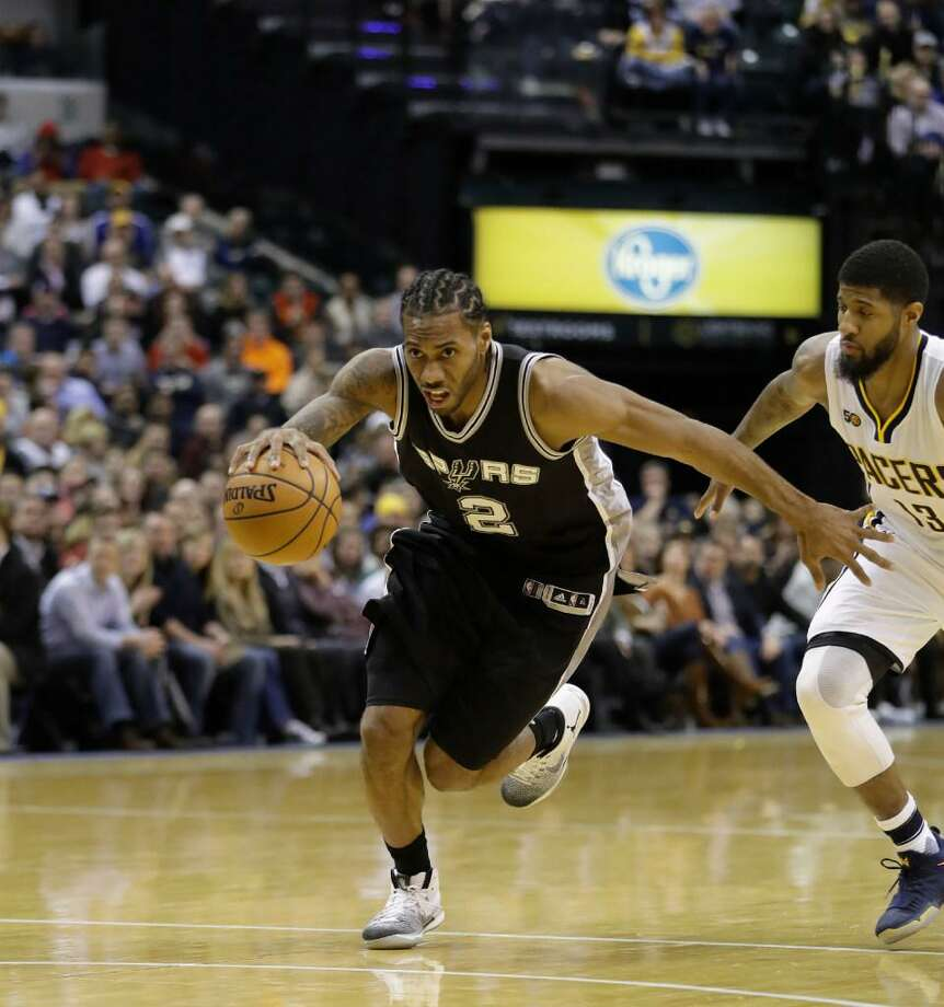 Kawhi Leonard drives past Indiana's Paul George during the Spurs' victory on Feb. 13, 2017 in Indianapolis. Photo: Darron Cummings /AP Photo