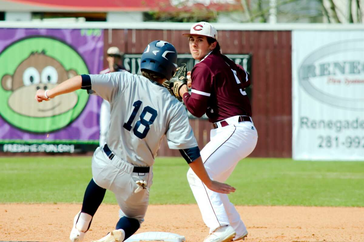 Clear Creek's Rex Kennedy (5) tries to turn a double play as Second Baptist's (18) is forced out at second base Thursday, Mar. 2 at Clear Creek High School.