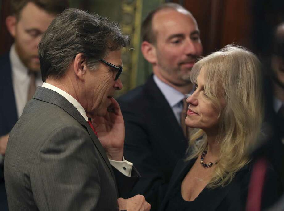 Kellyanne Conway, counselor to President Donald Trump, greets incoming Energy Secretary Rick Perry in the Eisenhower Executive Office Building in the White House complex in Washington. Photo: Andrew Harnik /Associated Press / Copyright 2017 The Associated Press. All rights reserved.