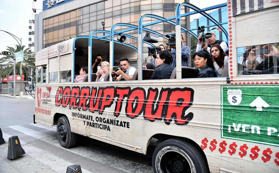 "Journalists and tourists are pictured on board of  the ""Corruptour"", a bus that offers a sightseeing tour through different points, institutions and companies in Mexico City, related to alleged great scandals of corruption in recent Mexican history, on February 5, 2017.  The ""Corruptour"" is a new and free touristic attraction launched and supported by NGO's and activists proposing a route arround 10 sites related to alleged corruption scandals such as the Mexican Senate, the offices of the Mexican Social Insurance Institute (IMSS), the Secretary of Governance and the facilities of the television station Televisa among other points. / AFP PHOTO / YURI CORTEZYURI CORTEZ/AFP/Getty Images Photo: YURI CORTEZ, AFP/Getty Images"