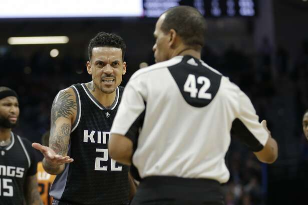 Sacramento Kings forward Matt Barnes, left, questions referee Eric Lewis about a foul called against him during the second half of an NBA basketball game agains the Phoenix Suns Friday, Feb. 3, 2017, in Sacramento, Calif. The Suns won 105-103. (AP Photo/Rich Pedroncelli)