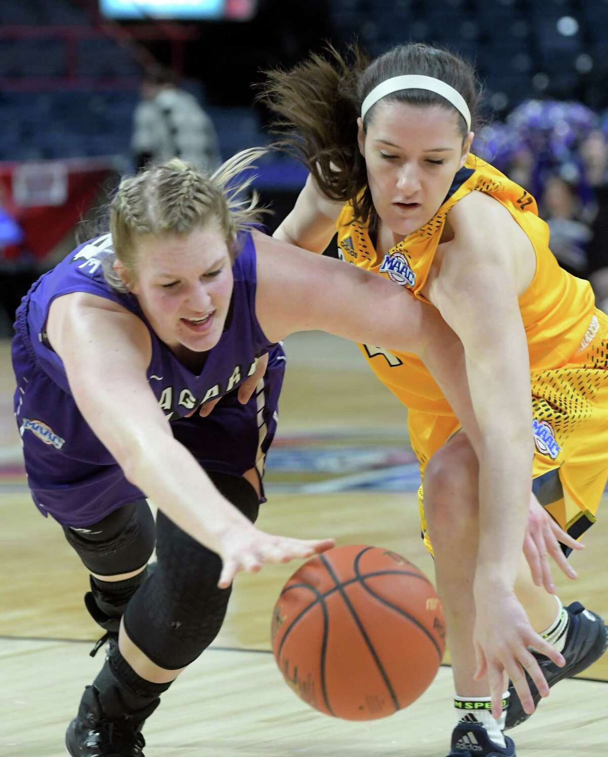 Kaylee Stroemple of Niagara, left, and Anna Sweny of Canisius battle for a loose ball during their MAAC Basketball Tournament game at the Times Union Center on Thursday, March 2, 2017, in Albany, N.Y. (Paul Buckowski / Times Union)